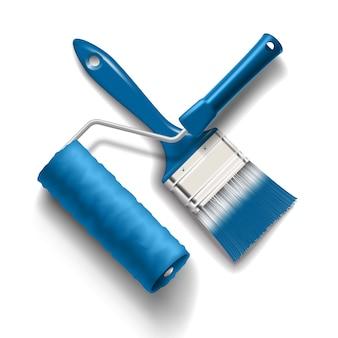 Strumenti di lavoro: pennello e rullo con vernice di colore blu