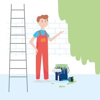 Uomo dell'operaio con il rullo di vernice del secchio delle scale