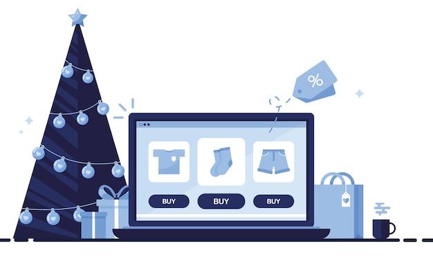 Posto di lavoro con decorazioni natalizie e computer portatile per ordinare regali per le feste, natale e capodanno. blu