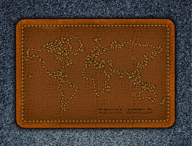 Mappa del mondo sull'etichetta in pelle. sfondo denim realistico