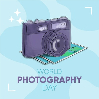 Fotocamera e mappe per la giornata mondiale della fotografia