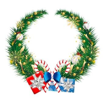 Elemento di design ghirlanda per auguri di natale e capodanno. coroncina decorata con giocattolo natalizio dorato e orpello, bastoncino di zucchero con confezione regalo avvolta festosa