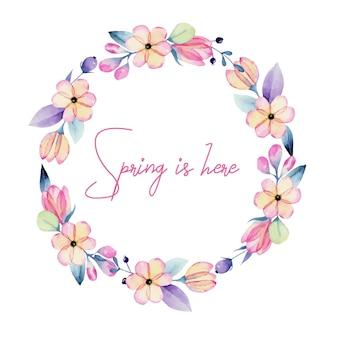 Ghirlanda di fiori pastello primaverili rosa e viola dell'acquerello