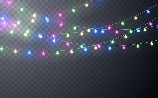 Ghirlanda di colori natalizi, decorazioni festive. incandescente luci di natale decorazione effetto trasparente su sfondo scuro.