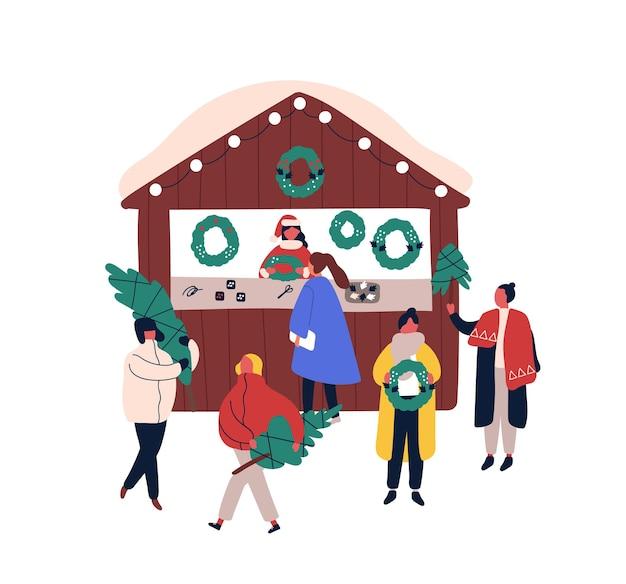 Decorazioni di natale chiosco piatto illustrazione vettoriale. personaggi dei cartoni animati di commessa e clienti. fiera di natale, elemento di design del mercato di strada stagionale. gente che compra abeti e ghirlande festive.