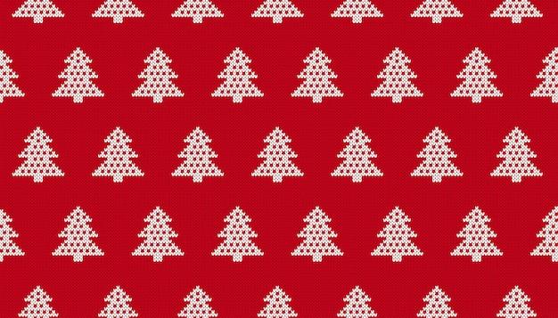 Modello natalizio a maglia. stampa senza cuciture con alberi di natale. trama maglione rosso lavorato a maglia. ornamento festivo. vettore