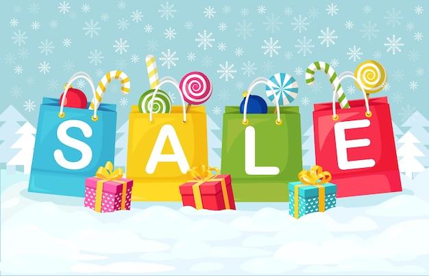 Natale, vendita di capodanno. borse per la spesa con caramelle, scatole regalo, palle di natale