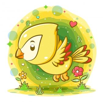 Volo giallo dell'uccello nel giardino