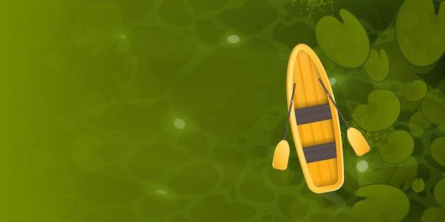 Una barca gialla galleggia attraverso una palude con foglie di ninfea