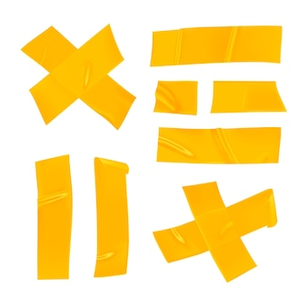 Set nastro adesivo giallo. pezzi di nastro adesivo giallo realistico