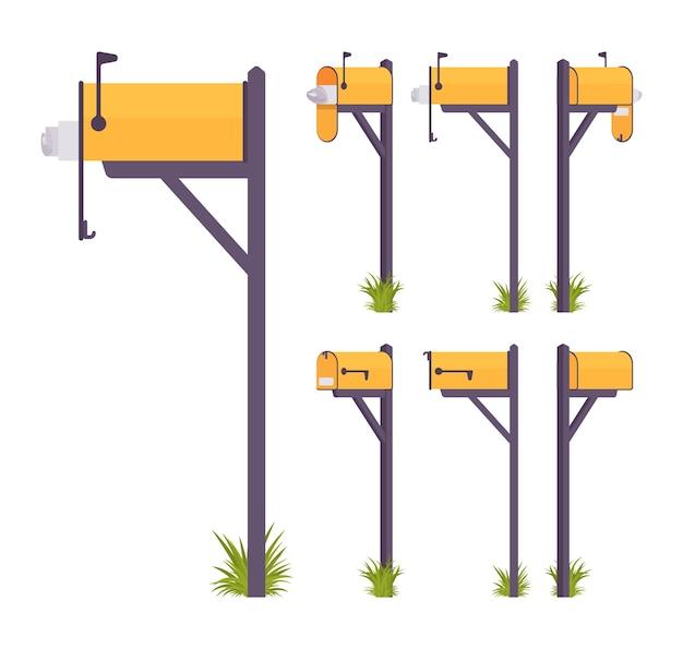 Insieme giallo della cassetta postale isolato su bianco
