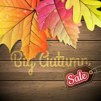 Foglie di autunno bagnate gialle manifesto di vendita sullo sfondo un vecchio legno scuro.