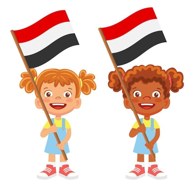 Bandiera dello yemen in mano. bambini che tengono bandiera. vettore di bandiera nazionale dello yemen