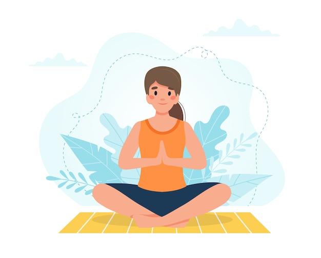 Yoga a casa. donna che fa yoga con il fondo delle foglie