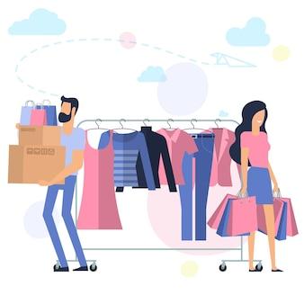 Yong uomo e donna allo shopping concetto piatto desin rosa e blu pronto per personaggi di animazione ed elementi di design rack con vestiti su grucce