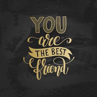 Sei il migliore amico scritto a mano in oro con lettere positive Vettore Premium