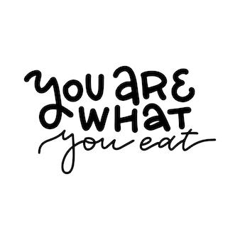 Sei quello che mangi, citazione di lettere disegnate a mano sul cibo sano
