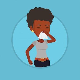 Giovane donna malata afroamericana che starnutisce.