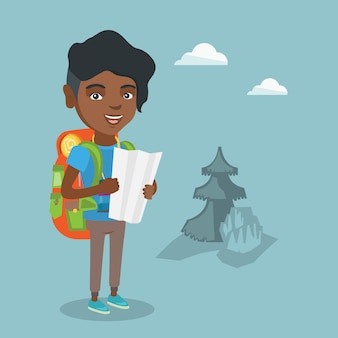 Giovane viaggiatore afro-americano, guardando la mappa.