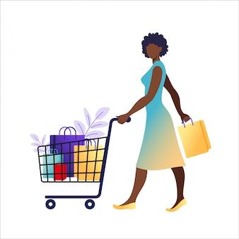 La giovane donna africana con i sacchi di carta va a fare spese. concetto di shopping online e offline, vendita, sconto.
