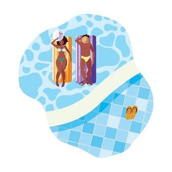 Giovani coppie afro con il materasso galleggiante in acqua