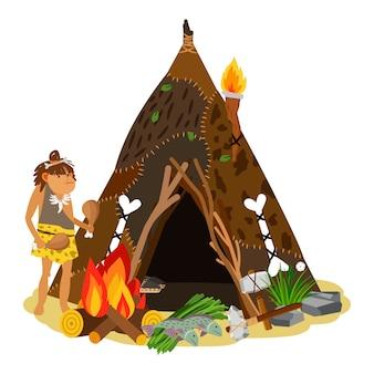Giovane ragazza antica che cucina al fuoco aperto