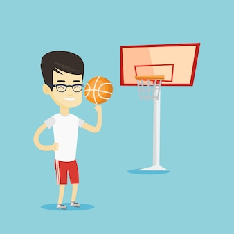 Sfera di filatura del giovane giocatore di pallacanestro.
