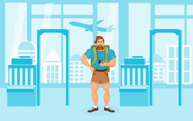 Giovane maschio hipster barbuto in occhiali in viaggio con lo zaino in aeroporto