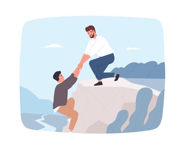 Giovane uomo barbuto che cerca di aiutare il suo amico appeso al bordo della scogliera e tirarlo fuori. salvataggio in montagna