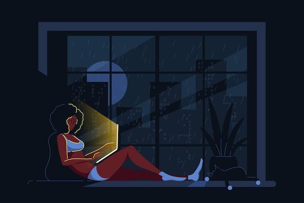 Giovane donna di colore a casa sdraiato sul davanzale della finestra e lavora al computer. lavoro a distanza, home office, concetto di autoisolamento. illustrazione di stile piatto