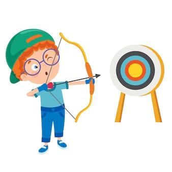 Un giovane ragazzo che gioca tiro con l'arco