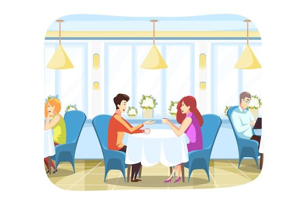 Giovane ragazzo e girlfrined uomo e donna seduti in un accogliente bar a bere il caffè
