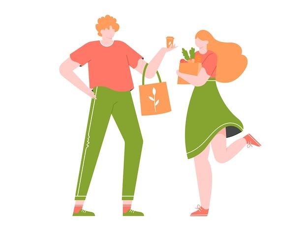 La giovane coppia sta facendo la spesa in un negozio senza plastica.