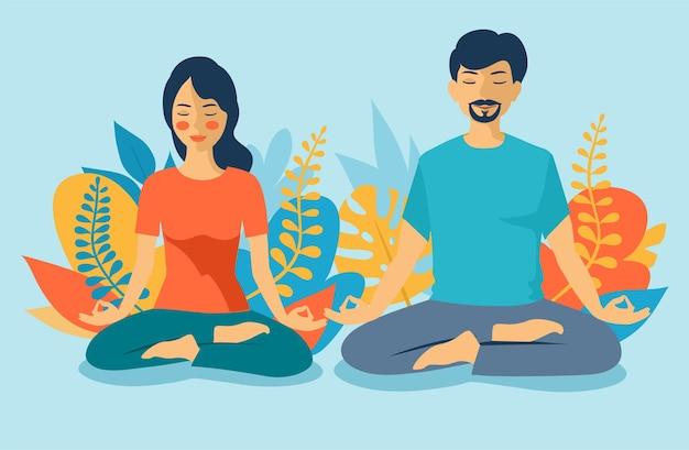 La giovane coppia medita nella posizione del loto, meditando insieme
