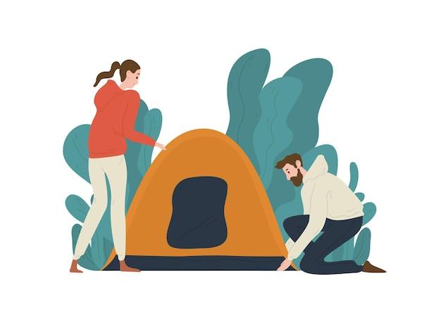 Coppia giovane installazione tenda in campeggio. coppia di simpatici turisti divertenti isolati su bianco