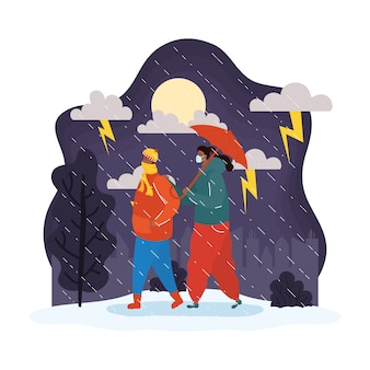 Giovani coppie che indossano maschere mediche nella scena del tempo piovoso