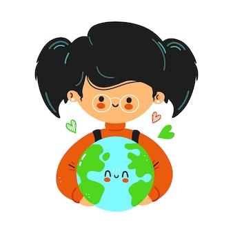 La giovane ragazza carina e divertente tiene in mano il pianeta terra