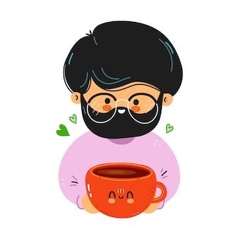 Il giovane uomo carino e divertente tiene in mano una tazza di caffè