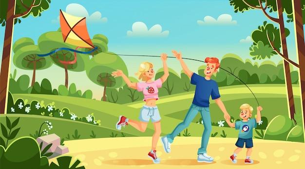 Giovane famiglia bambino figlio aquilone volante nel parco cittadino