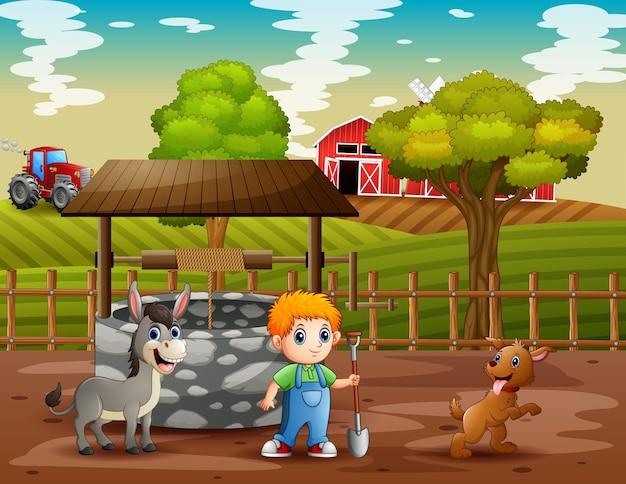 Giovane agricoltore e animali nei terreni agricoli