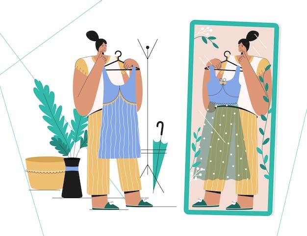 La ragazza sceglie il nuovo vestito in piedi davanti allo specchio