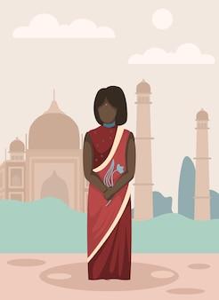 Ragazza in sari rossi con punto rosso sulla fronte.