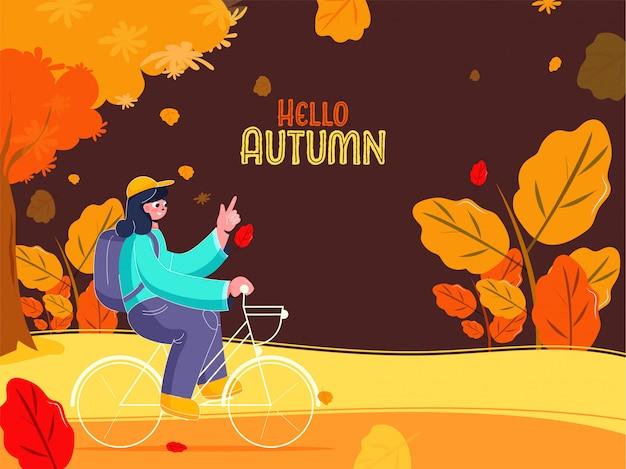 Bicicletta di guida della ragazza con uno zaino sulla priorità bassa marrone di vista della natura per l'autunno di ciao.