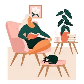 Ragazza che si siede in poltrona comoda e che beve tè o caffè nella sala fornita nello stile scandinavo. donna che passa la sera a casa.