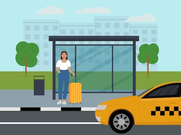 Una giovane ragazza sta alla fermata dell'autobus e aspetta il suo taxi