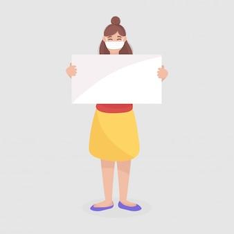 Giovane ragazza che indossa una maschera protettiva e in possesso di un foglio bianco per il tuo messaggio.