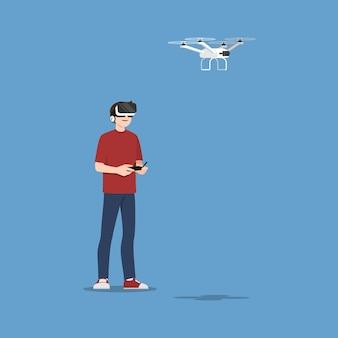 Carattere di giovane uomo bello indossare occhiali vr controllando un multi-elicottero drone con fotocamera