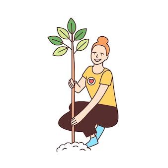 Giovane volontario femminile felice o ecologo che pianta albero nel parco isolato su bianco