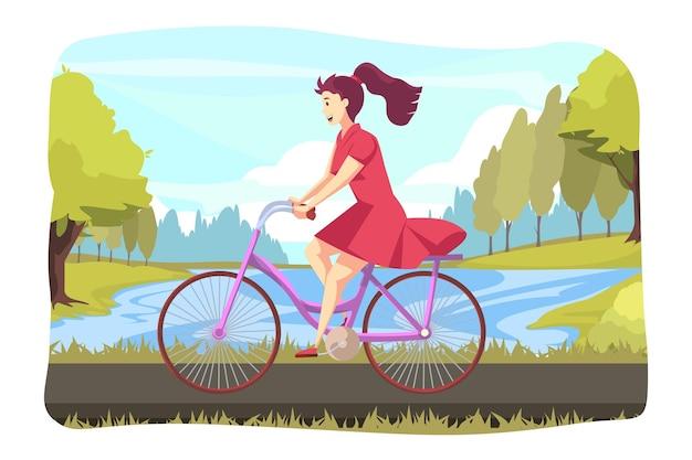Giovane donna felice o ragazza in bicicletta di guida del carattere al parco o alla piazza