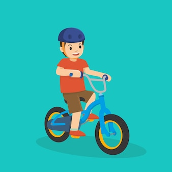 Un ragazzino in sella a una bicicletta